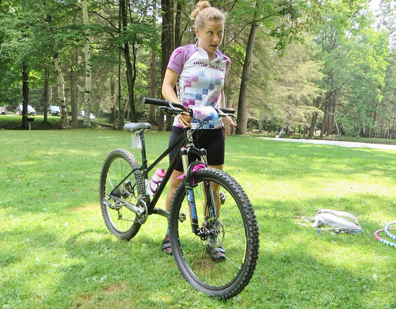 Mary Hannah Parkman, founder of the Berkshire chapter of Little Bellas mentoring on mountain bikes program for girls talks about bike care and safety during this week's pilot program.