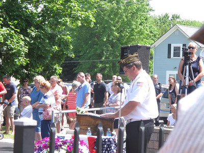 ELIZABETH DOBBINS / GAZETTE Officer of the day and member of the Valley City Veterans of Foreign Wars Paul Yagel leads a Memorial Day ceremony in Liverpool Township.