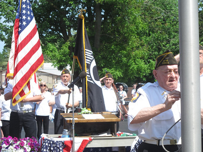 ELIZABETH DOBBINS / GAZETTE Willie Orth, 80, secures the flag during the Memorial Day Ceremony in Liverpool Township. Orth is a member of the Valley City Veterans of Foreign Wars and served in Germany in 1956 through 1959.