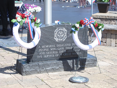 ELIZABETH DOBBINS / GAZETTE Valley City Veterans of Foreign Wars Post 5563 decorated the memorial throughout the Memorial Day service.