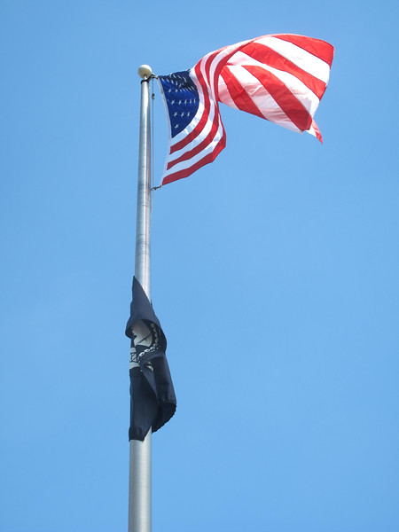 ELIZABETH DOBBINS / GAZETTE The American flag blows in the wind during the Liverpool Township Memorial Day ceremony.