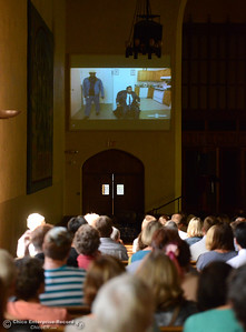 "Lloyd Pendleton, a prominent ""housing first"" advocate for homeless people, shows a ""The Daily Show with Jon Stewart"" clip while speaking to members of the Chico community Monday, Oct. 10, 2016, at Bidwell Presbyterian Church in Chico, California. (Dan Reidel -- Enterprise-Record)"
