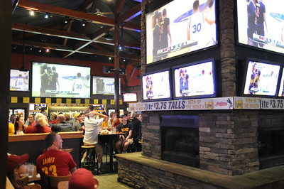 ASHLEY FOX / GAZETTE It was a packed venue at Buffalo Wild Wings in Medina as fans of the Cleveland Cavaliers waited in anticipation just before a play Sunday night in Game 7 of the NBA Finals against the Golden State Warriors.