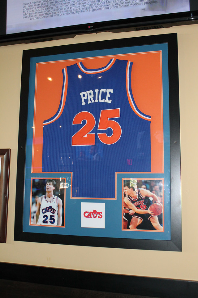 LAWRENCE PANTAGES / GAZETTE  On Tap Grille in Montville Township pays homage to Cavs tradition with a framed replica of a Mark Price jersey from the 1990s.