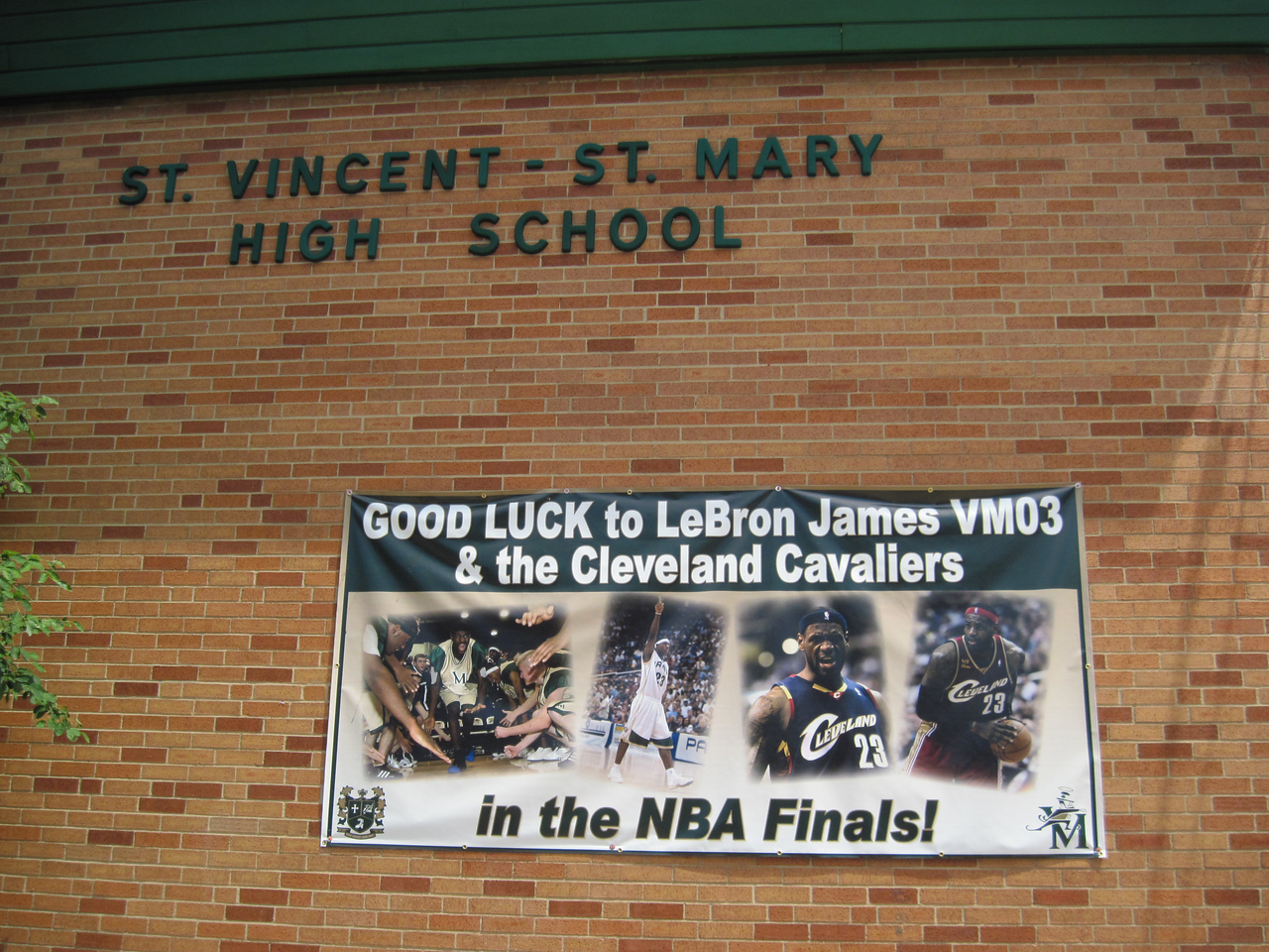 LAWRENCE PANTAGES / GAZETTE The alma mater of Cavaliers star LeBron James, St. Vincent-St. Mary High School in downtown Akron, adorned the front of its building with a banner showing support for James heading into Sunday's Game 7 of the NBA Finals.