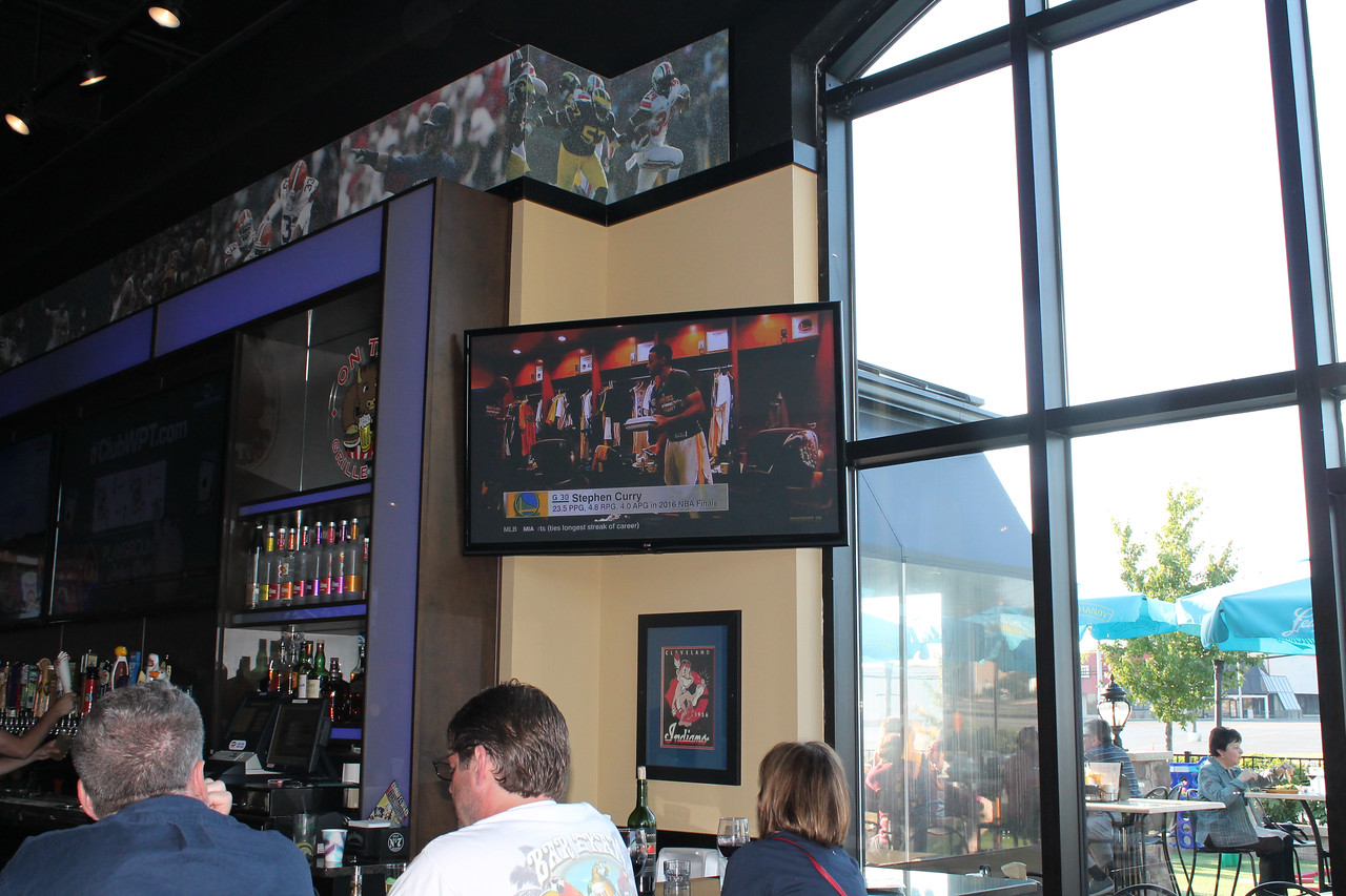 LAWRENCE PANTAGES / GAZETTE Golden State Warriors star player Steph Curry could be seen on one of 42 TVs at On Tap Grille in Montville Township getting ready for Game 7 vs. the Cavaliers.