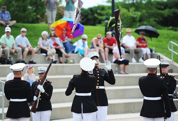 Globe/T. Rob Brown<br /> The Topeka Jr. ROTC Marine Rifle Team performs a rifle drill during Memorial Day at the Memorial, Monday, May 27, 2013, at the Veterans Memorial Amphitheater in Pittsburg, Kan.