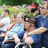 Globe/T. Rob Brown<br /> Rachel Murphey (right) holds her husband Jerry Murphey, both of Carthage, during Memorial Day services, Monday, May 27, 2013, at Park Cemetery in Carthage. Jerry Murphey is a member Crossroads Chapter 41, Disabled American Veterans, in Carthage.