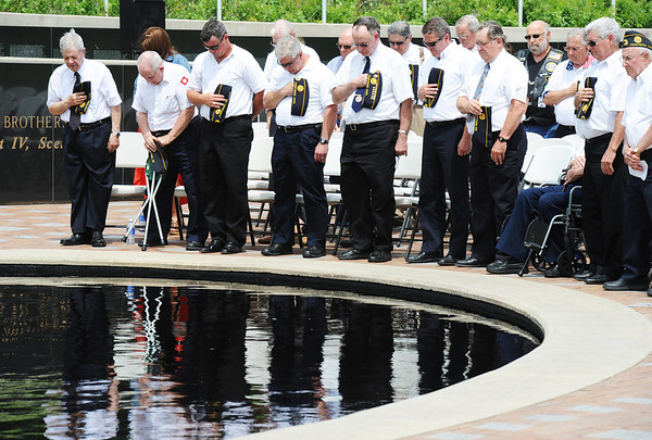 Globe/T. Rob Brown<br /> Veterans remove their hats to pray along with Rev. Blair Thompson (not pictured) during Memorial Day at the Memorial, Monday, May 27, 2013, at the Veterans Memorial Amphitheater in Pittsburg, Kan.