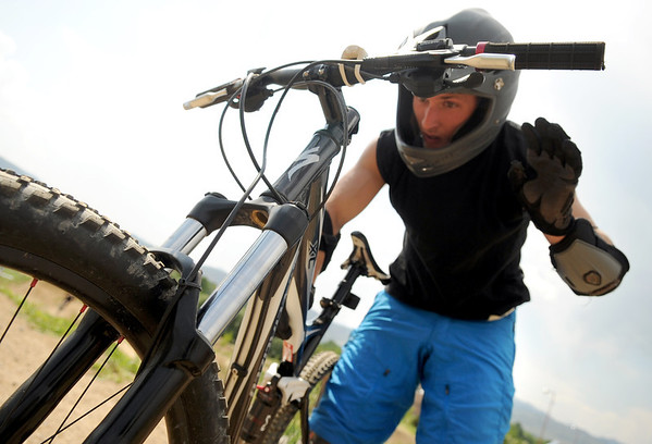 "Adam Shapiro, of Denver, tries to figure out a problem with his bike on Saturday, June 11, at the new Valmont Bike Park in Boulder. For more photos and a video of the bike park's opening day go to  <a href=""http://www.dailycamera.com"">http://www.dailycamera.com</a><br /> Jeremy Papasso/ Camera"