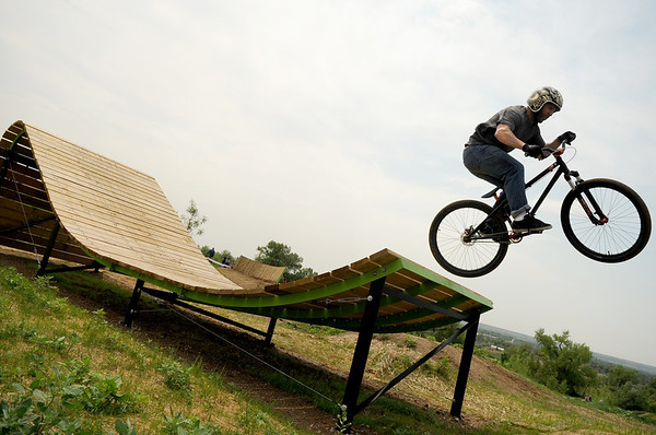 "Ray Luscombe, of Denver, gets some air off a feature at the Valmont Bike Park in Boulder county on Saturday, June 11. For more photos and video go to  <a href=""http://www.dailycamera.com"">http://www.dailycamera.com</a><br /> Jeremy Papasso/ Camera"