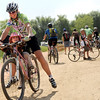 "Margell Abel, of Boulder, laughs as her daughter Haydn Hludzinski, 5, tries to pedal their bike on Saturday, June 11, at the new Valmont Bike Park in Boulder. For more photos and a video of the bike park's opening day go to  <a href=""http://www.dailycamera.com"">http://www.dailycamera.com</a><br /> Jeremy Papasso/ Camera"