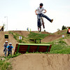 A biker throws a one-footed trick off a jump at the Valmont Bike Park on Saturday, June 11, in Boulder County.<br /> Jeremy Papasso/ Camera