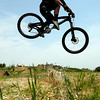 "A mountain biker hits  a jump on Saturday, June 11, at the new Valmont Bike Park in Boulder. For more photos and a video of the bike park's opening day go to  <a href=""http://www.dailycamera.com"">http://www.dailycamera.com</a><br /> Jeremy Papasso/ Camera"