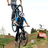 "A biker nearly gets landed on by another biker after hitting a jump on Saturday, June 11, at the new Valmont Bike Park in Boulder. For more photos and a video of the bike park's opening day go to  <a href=""http://www.dailycamera.com"">http://www.dailycamera.com</a><br /> Jeremy Papasso/ Camera"