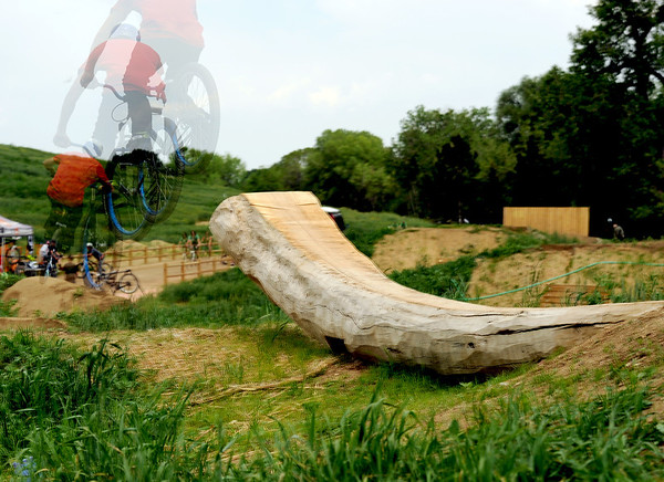 "A mountain biker rides off a log on Saturday, June 11, at the new Valmont Bike Park in Boulder. For more photos and a video of the bike park's opening day go to  <a href=""http://www.dailycamera.com"">http://www.dailycamera.com</a><br /> Jeremy Papasso/ Camera"