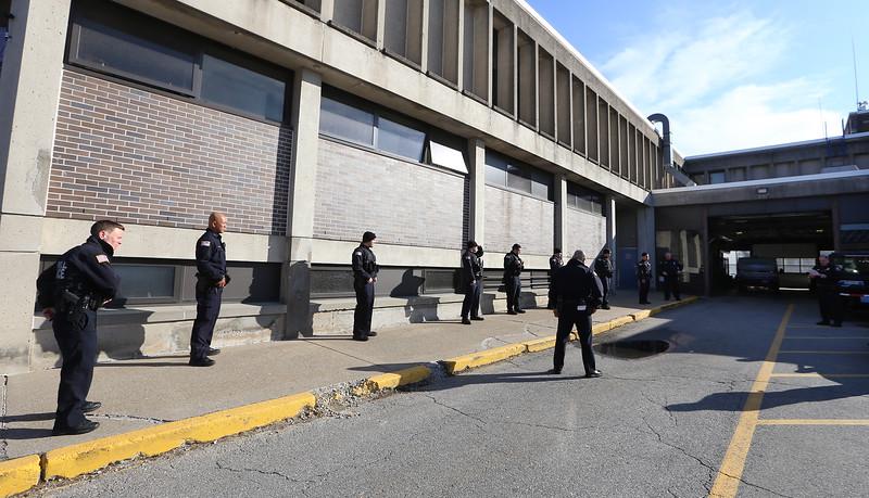 Lowell Police hold roll call outdoors due to coronavirus/covid-19 crisis.  (SUN/Julia Malakie)