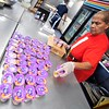 BEN GARVER — THE BERKSHIRE EAGLE<br /> Nadine Oliver sets out yogurt to go with lunch for visitors to the Christian Center, Thursday, December 12, 2019. <br /> Cutbacks in the The Supplemental Nutrition Assistance Program (SNAP) will affect about Ten Thousand people in Western Mass. Thursday, December 12, 2019.
