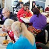 BEN GARVER — THE BERKSHIRE EAGLE<br /> Visitors to the Christian Center eat a warm lunch of chilli with garlic bread, slaw and yogurt, Thursday, December 12, 2019. Cutbacks in the The Supplemental Nutrition Assistance Program (SNAP) will affect about Ten Thousand people in Western Mass.