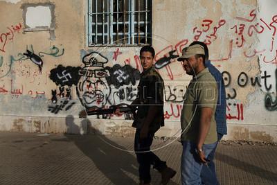 A group of libyan rebel fighters walks in Benghazi Down Town, Benghazi, Lybia, May 4, 2011. (Austral Foto/Nicolas Garcia)