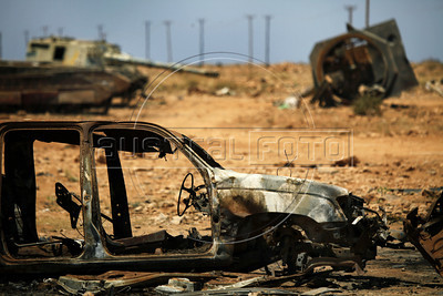 Tanks and a car destroyed by NATO's bombing on the way between Benghazi and Ajdabiya, Lybia, May 14, 2011. (Austral Foto/Nicolas Garcia)