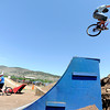 "Colin Zimmerman, of Morrison, catches some air on a dirt jump while practicing for Saturday's competition on Friday, June 8, during the Lyons Outdoor Games in Lyons. For a video of the event go to                                               <a href=""http://www.dailycamera.com"">http://www.dailycamera.com</a><br /> Jeremy Papasso/ Camera"