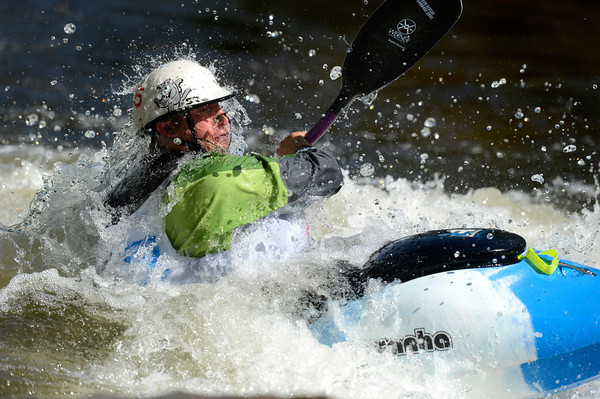 "David Fusilli maneuvers the rapids on Friday, June 8, while competing in the prelims of the pro freestyle kayaking during the Lyons Outdoor Games in Lyons. For a video of the event go to                                               <a href=""http://www.dailycamera.com"">http://www.dailycamera.com</a><br /> Jeremy Papasso/ Camera"