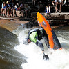 "Mike Patterson throws down a big trick during the pro kayaking preliminary qualification on Friday, June 8, during the Lyons Outdoor Games in Lyons. For a video of the event go to                                               <a href=""http://www.dailycamera.com"">http://www.dailycamera.com</a><br /> Jeremy Papasso/ Camera"