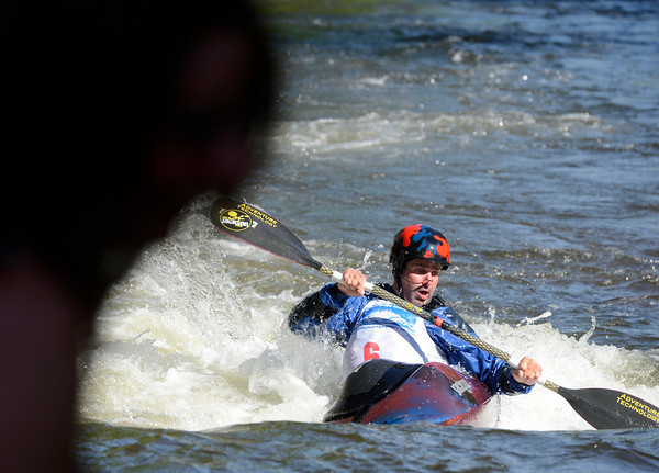 "Billy Malesky maneuvers the rapids in front of a spectator, at left, on Friday, June 8, while competing in the prelims of the pro freestyle kayaking during the Lyons Outdoor Games in Lyons. For a video of the event go to                                               <a href=""http://www.dailycamera.com"">http://www.dailycamera.com</a><br /> Jeremy Papasso/ Camera"