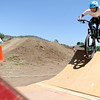 "Nick Simcik, rides over a feature at the Lyons Bike Park at Bohn Park on Friday, June 8, during the Lyons Outdoor Games in Lyons. For a video of the event go to                                               <a href=""http://www.dailycamera.com"">http://www.dailycamera.com</a><br /> Jeremy Papasso/ Camera"