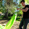 """Sunny Kaercher, left and Richard Mapes tie up a hammock in Beach Park on University Hill on Thursday evening as part of the Finding Ground project. There will be a Map to Nap at each location to find the various hammock sites.<br /> For more photos of the set up go to  <a href=""""http://www.dailycamera.com"""">http://www.dailycamera.com</a><br /> Photo by Paul Aiken / The Camera / June 2, 2011"""