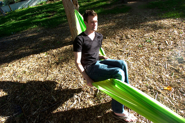 """Richard Mapes tests out a hammock in Beach Park on University Hill on Thursday evening as part of the Finding Ground project. There will be a Map to Nap at each location to find the various hammock sites.<br /> For more photos of the set up go to  <a href=""""http://www.dailycamera.com"""">http://www.dailycamera.com</a><br /> Photo by Paul Aiken / The Camera / June 2, 2011"""