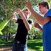 """Richard Mapes, left and Jack Ricci work to tie up a hammock in Beach Park on University Hill on Thursday evening as part of the Finding Ground project. There will be a Map to Nap at each location to find the various hammock sites.<br /> For more photos of the set up go to  <a href=""""http://www.dailycamera.com"""">http://www.dailycamera.com</a><br /> Photo by Paul Aiken / The Camera / June 2, 2011"""