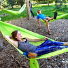 """Sunny Kaercher and Jack Ricci try out their hammocks in Beach Park on University Hill on Thursday evening as part of the Finding Ground project. There will be a Map to Nap at each location to find the various hammock sites.<br /> For more photos of the set up go to  <a href=""""http://www.dailycamera.com"""">http://www.dailycamera.com</a><br /> Photo by Paul Aiken / The Camera / June 2, 2011"""