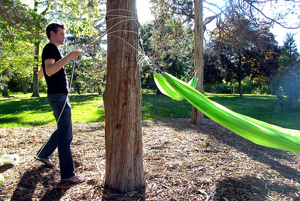 "Richard Mapes works on another hammock in Beach Park on University Hill on Thursday evening as part of the Finding Ground project. There will be a Map to Nap at each location to find the various hammock sites.<br /> For more photos of the set up go to  <a href=""http://www.dailycamera.com"">http://www.dailycamera.com</a><br /> Photo by Paul Aiken / The Camera / June 2, 2011"