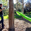 """Richard Mapes works on another hammock in Beach Park on University Hill on Thursday evening as part of the Finding Ground project. There will be a Map to Nap at each location to find the various hammock sites.<br /> For more photos of the set up go to  <a href=""""http://www.dailycamera.com"""">http://www.dailycamera.com</a><br /> Photo by Paul Aiken / The Camera / June 2, 2011"""