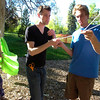 """From left to right Sunny Kaercher, Richard Mapes and Jack Ricci work together to hand a hammock in Beach Park on University Hill on Thursday evening as part of the Finding Ground project. There will be a Map to Nap at each location to find the various hammock sites.<br /> For more photos of the set up go to  <a href=""""http://www.dailycamera.com"""">http://www.dailycamera.com</a><br /> Photo by Paul Aiken / The Camera / June 2, 2011"""