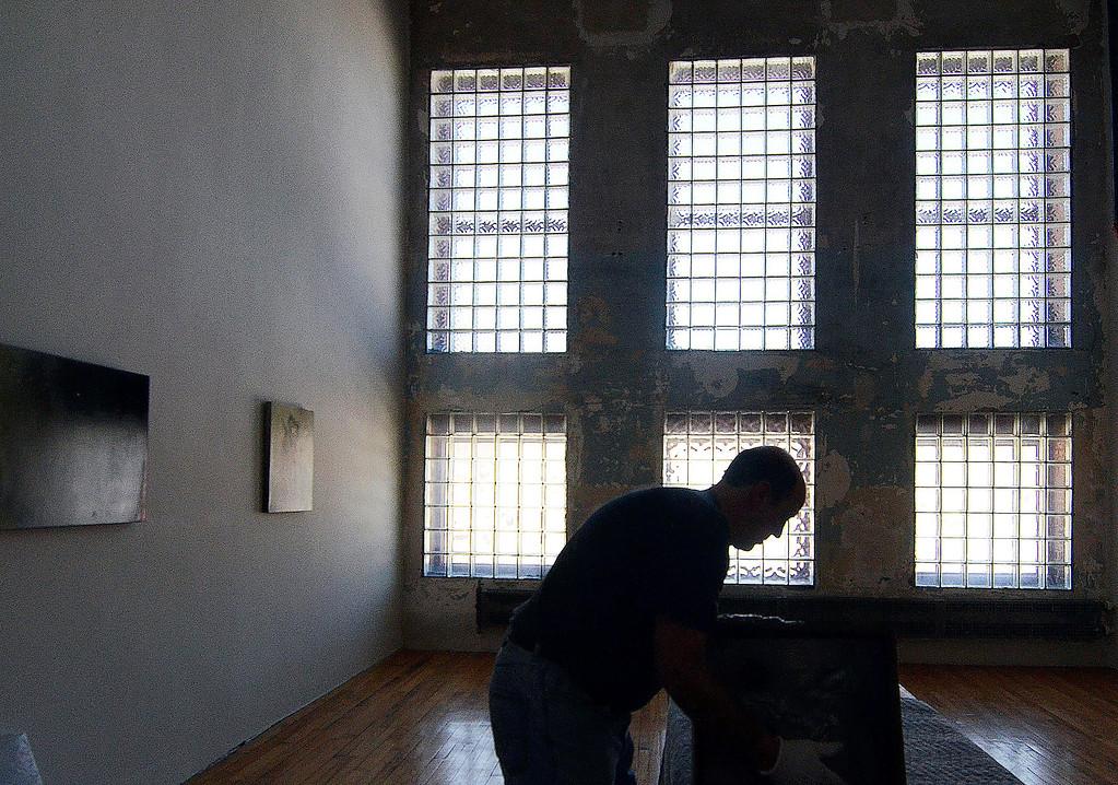 . John Carli works on an installation at MASS MoCA, Thursday March 6, 2014.  Ben Garver / The Berkshire Eagle / photos.berkshireeagle.com