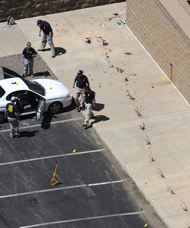 Police investigate the suspects car outside a movie theater after a shooting Friday, July 20, 2012 in Aurora, Colo.  A gunman wearing a gas mask set off an unknown gas and fired into the crowded movie theater killing 12 people and injuring at least 50 others, authorities said. (AP Photo/The Denver Post, Helen H. Richardson) TV, INTERNET AND MAGAZINES CALL FOR RATES AND TERMS