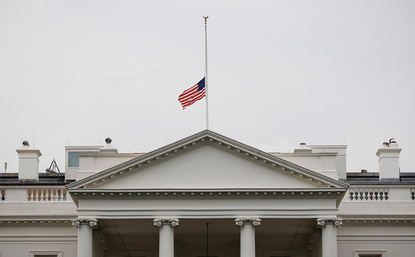 A US is flag is seen at half-staff over the White House in Washington, Friday, July 20, 2012. President Barack Obama, who cut short his campaign stop in Florida, order the flag to be lowered in the aftermath of the tragic mass shooting at a movie theater in Aurora, Colo.(AP Photo/Pablo Martinez Monsivais)