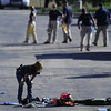 Agents from the FBI and ATF investigate the scene behind the Century 16 theater in Aurora, Colo.,  following a shooting on Friday, July 20, 2012. A gunman wearing a gas mask set off an unknown gas and fired into the crowded movie theater killing 12 people and injuring at least 50 others, authorities said.   (AP Photo/The Denver Post, AAron Ontiveroz) TV, INTERNET AND MAGAZINES CALL FOR RATES AND TERMS