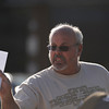 Tom Sullivan holds up a photo of his son Alex for media outside Gateway High School, Friday July 20, 2012, in Aurora. Sullivan is still missing his son, who he said was at the movies where about 50 people were shot 12 fatally early Friday in Aurora. RJ Sangosti, The Denver Post