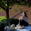 Amanda Medek sits outside Gateway High School in Aurora, Colo., where witnesses we being interviewed by authorities Friday July 20, 2012.  A gunman wearing a gas mask set off an unknown gas and fired into the crowded movie theater killing 12 people and injuring at least 50 others, authorities said. (AP Photo/The Denver Post, Craig F. Walker) TV, INTERNET AND MAGAZINES CALL FOR RATES AND TERMS