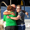 Tom Sullivan, center, hugs two women outside Gateway High School, Friday July 20, 2012, in Aurora. Sullivan is still missing his son, who he said was at the movies where about 50 people were shot 12 fatally early Friday in Aurora. RJ Sangosti, The Denver Post