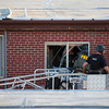Police investigate the suspects apartment near the intersection of 17th Street and Paris Street on Friday, July 20, 2012. Stephen Mitchell, The Denver Post