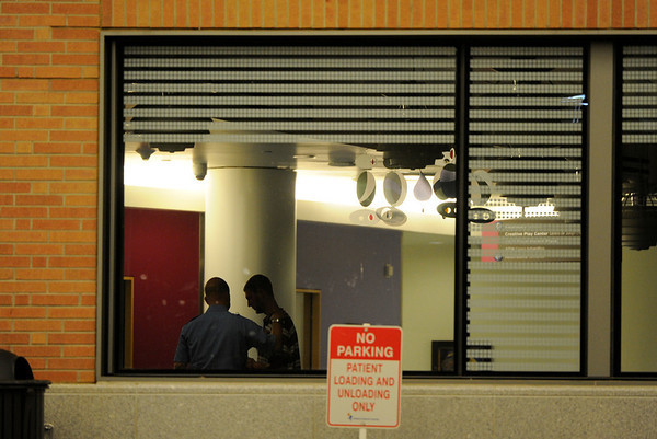 A man arrives at Children's Hospital in Aurora, CO, Friday, July 20, 2012. Fourteen people were killed and about 50 were injured early Friday when shots rang out at an Aurora movie theater during a premiere showing of the new Batman movie. Craig F. Walker, The Denver Post