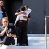 Two police officers embrace outside Gateway High School in Aurora, CO, where witnesses we being interviewed by authorities Friday, July 20, About 50 people were shot 12 fatally early Friday when shots rang out at an Aurora movie theater during a premiere showing of the new Batman movie. A 24-year-old man in is custody 2012. Craig F. Walker, The Denver Post