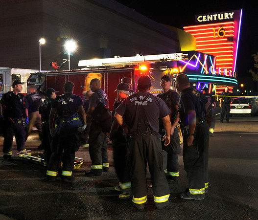 Aurora paramedics transported dozen of injured Friday morning. Aurora Police responded to the Century 16 movie theatre early Friday morning, July 20, 2012. Scanner traffic indicates that dozens of people were hurt in an incident inside the theatre. Karl Gehring/The Denver Post