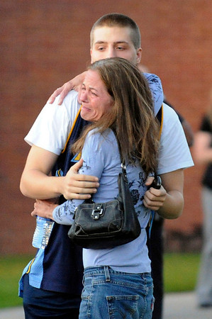 Tammi Stevens, is overcome with emotion as she picks up her son, Jacob Stevens, outside Gateway High School, Friday July 20, 2012, in Aurora. Jacob was a witnesses to a shooting, where about 50 people were shot 12 fatally early Friday inside an Aurora movie theater during a premiere showing of the new Batman movie, were taken to the high school by bus to be questioned by police. RJ Sangosti, The Denver Post