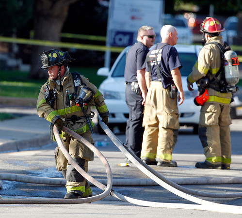 Firefighters work in front of an apartment where the suspect in a theatre shooting lived in Aurora, Colo., on Friday, July 20, 2012. As many as 12 people were killed and 50 injured at a shooting at the Century 16 movie theatre on Friday. The suspect is identified as 24-year-old James Holmes.  (AP Photo/Ed Andrieski)